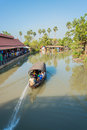 Water tourist boat floats through the canal ayudthaya thailand march with tourists of thailand countryside on march is thai Stock Photo