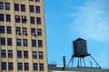 Water tower and high-rise building Royalty Free Stock Photo