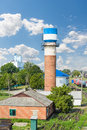 Water tower the is photographed against the blue sky Royalty Free Stock Images