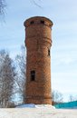 Water tower of red brick on a background blue sky Royalty Free Stock Photo