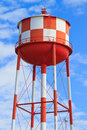 Water tower red white stripes blue sky background Stock Image