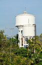 Water tower white among tropical trees Stock Images