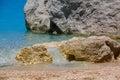 Water trough beach rock on porto katsiki Stock Photos