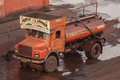 Water truck in a grimy coal port paradip india th january Stock Photo