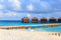 Water villas in tropical resort sea Royalty Free Stock Photo