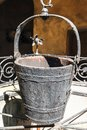 A water well with an old bucket Royalty Free Stock Photo