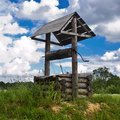Water well wooden in the field against the sky Royalty Free Stock Photography