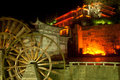 Water wheel landmark of lijiang dayan old town at night beautiful scene the waterwheel in ancient yunnan province southwestern Stock Photos