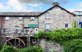 Water wheel and mill with at ambleside cumbria in the english lake district Royalty Free Stock Photo