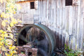 Water wheel in motion at vintage grist mill. Royalty Free Stock Photo