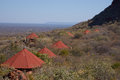 Waterberg plateau red roofs of the lodge in namibia nestling high on the slope of with views across the endless kalahari Stock Photo