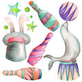 A watercolor circus set with the hand drawn elements: a fur seal with a ball, a hat with a rabbit and circus bowls. Royalty Free Stock Photo