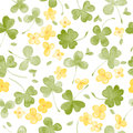 Watercolor Clover and little flowers seamless vector pattern
