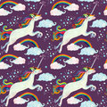 Watercolor fairy tale seamless pattern with flying unicorn, rainbow, magic clouds and rain