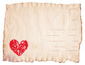 Watercolor heart painted on vintage scorched postcard red Stock Photo
