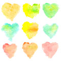 Watercolor heart shaped stains isolated on white background. Set of red, yellow, blue, green, orange hand painted spots