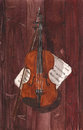 Watercolor illustration of a violin and notes on a wood background