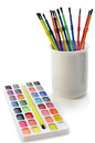 Watercolor paints and brushes for school on white background Stock Photo