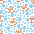 Watercolor pattern blue polka dots and rocking horse .seamless colorful set of children`s illustrations in a watercolor style.