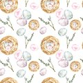 Watercolor seamless pattern with symbols of spring and Easter holiday, eggs, bird nest and tree branch on white background