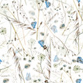 Watercolor summer seamless pattern with wildflowers and blue butterflies Royalty Free Stock Photo