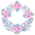 Watercolor tropical indigo floral wreath with pink hibiscus frangipani and leaves of indigo palm monstera