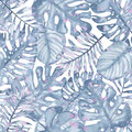 Watercolor tropical seamless pattern hand painted with leaves of indigo palm monstera