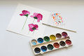 Watercolors, brush and painting of beautiful pink flowers on white background, artistic workplace