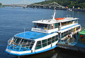 Watercraft is back at its mooring after the river tour passengers are leaving their sightseeing along dnieper in kyiv ukraine Royalty Free Stock Photo