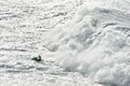 Watercraft escaping from a huge wave breaking Royalty Free Stock Image