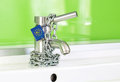 Waterdrop dripping out modern faucet locked lock chain european commission Stock Photos