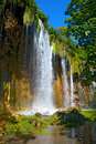 Waterfall against the blue sky Royalty Free Stock Photography