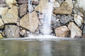 Waterfall artificial flowing against stone wall Royalty Free Stock Images