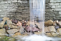 Waterfall artificial flowing against stone wall Royalty Free Stock Image