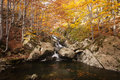Waterfall in autumn a colorful forest Stock Photo