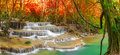 Waterfall in autumn forest. Royalty Free Stock Photo