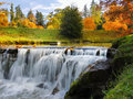 Waterfall autumn landscape colours brightly colored river and Royalty Free Stock Photo