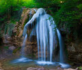 Waterfall beautiful clean flowing in the green forest Stock Images