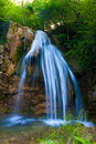 Waterfall beautiful clean flowing in the green forest Royalty Free Stock Photos