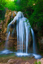 Waterfall beautiful clean flowing in the green forest Stock Photo