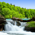 Waterfall beautiful in spring landscape Stock Image