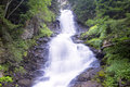 Waterfall (blurred motion). Color image Royalty Free Stock Photo