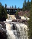 Waterfall  And Bridge At Gooseberry Falls Royalty Free Stock Photo