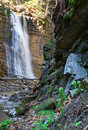 Waterfall and brook in mountain forest ravine Stock Photography