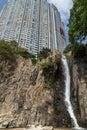 Waterfall and building at the Waterfall Bay in Hong Kong Royalty Free Stock Photo