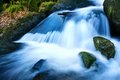 Waterfall with cool colors mountain creek waterfalls long exposure for soft water look Stock Photo