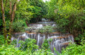 Waterfall in deep rain forest jungle huay mae kamin waterfall i kanchanaburi province thailand Royalty Free Stock Image