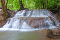 Waterfall in deep rain forest jungle huay mae kamin waterfall kanchanaburi province thailand Royalty Free Stock Image