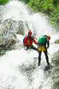 Waterfall descent by professional canyoning istructors Stock Photos
