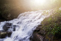 The waterfall flows down from the mountains Royalty Free Stock Photo
